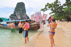 Tourists buying lunch on the Pi Pi island. Pi Pi Island, Thailand - November 14: Crowded beach with tourists all over in winter November 14, 2010 on Pi Pi Island Stock Photos