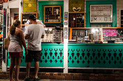 Tourists buying at roadside shop Stock Photography