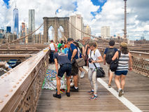 Tourists buying souvenirs at the Brooklyn Bridge in New York Stock Image