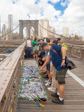 Tourists buying souvenirs at the Brooklyn Bridge in New York Stock Photo
