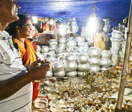 Tourists buying utensils from Puri Street hawkers Royalty Free Stock Photos