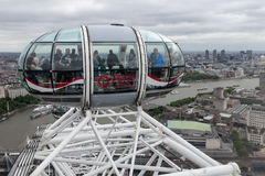 Tourists in cabin London Eye with aerial view London, England Stock Images