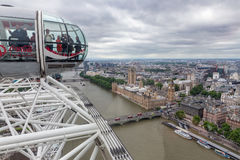 Tourists in cabin London Eye with aerial view London, England Royalty Free Stock Photo