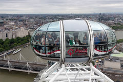 Tourists in cabin London Eye with aerial view London, England Royalty Free Stock Images