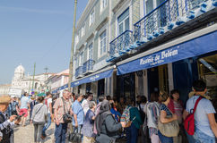 Tourists by a cafe in Lisbon Stock Photos