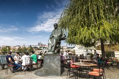 Tourists in cafes on the banks of the Vltava river near the monument to famous czech composer Bedrich Smetana infront of The Bedri. Ch Smetana Museum., Prague Stock Images