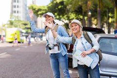 Tourists calling taxi Stock Image