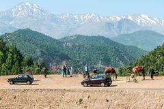 Tourists with camel in the mountains Royalty Free Stock Photography