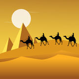 Tourists on camels in desert Stock Images