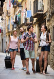 Tourists with camera and map walking Royalty Free Stock Photography