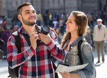 Tourists with camera outdoors Stock Photography