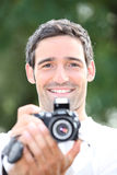 Tourists with camera Royalty Free Stock Photo