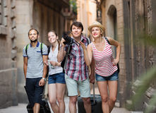 Tourists with camera walking at the street Stock Images