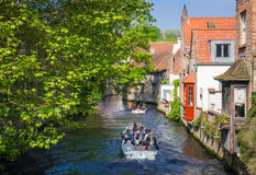 Tourists on a canal boat tour in Bruges Stock Image