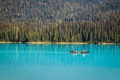 Tourists in canoe on Emerald Lake royalty free stock photo