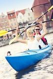 Tourists canoeing around the city Stock Photo