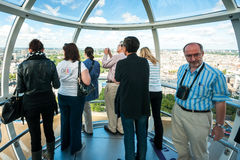 Tourists in the capsule of London Eye in London Stock Photo