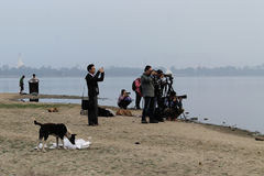 Tourists capturing the sunrise over U-Bein Bridge Royalty Free Stock Photography