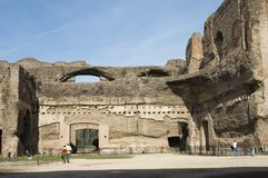 Tourists on Caracalla's Baths site. Tourists visiting the Thermae of Caracalla or Baths of Caracalla, ancient roman public baths and leisure centre, Rome, Italy royalty free stock image