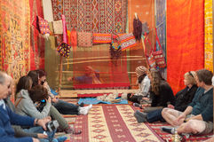Tourists in carpet shop, Morocco Royalty Free Stock Photo