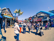 Tourists with carriage on Fisherman`s Wharf, Pier 39 in sun light Stock Image