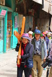 Tourists carrying the cross Stock Image