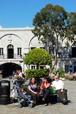 Tourists in Casemates Square, Gibraltar. Tourists sitting on a bench in Grand Casemates Square, Gibraltar, United Kingdom, Western Europe Royalty Free Stock Photo