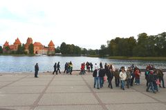 Tourists in the castle of Trakai Royalty Free Stock Image