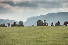 Tourists at Castlerigg stone circle. KESWICK, UK - SEP 9, 2014: Tourists enjoy the Castlerigg stone circle in the Cumbrian Lake District stock photos