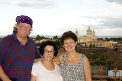 Tourists Cathedral of Granada Nicaragua. Middle age tourists on La Merced Church with view Cathedral of Granada Nicaragua Central America Spanish tile rooftops Stock Photography