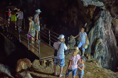 Tourists in the cave Stock Photography
