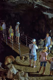 Tourists in the cave Royalty Free Stock Photography