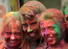 Tourists celebrate Holi or indian hindu festival of colors an annual event royalty free stock photo