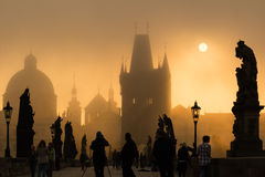 Tourists on Charles bridge early morning Royalty Free Stock Images