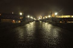 Tourists on the Charles bridge in Prague by night Royalty Free Stock Image