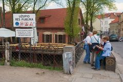 Tourists check map at the entrance to the Uzupis area in Vilnius, Lithuania. Stock Photo