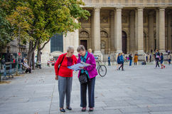Tourists Check Their Map At Place St. Sulpice Stock Photography