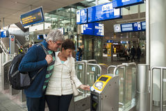 Tourists checking in bij NS, the Netherlands Royalty Free Stock Photography