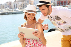 Tourists checking map on tablet Stock Photography