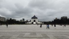 Tourists at Chiang Kai Shek memorial hall in Taiwan. The building is famous landmark and must see attraction in Taipei stock video