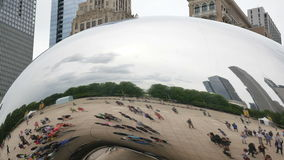 Tourists at the Chicago Bean Monument in Millennium Park Closeup stock video footage