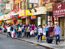 Tourists and chinese immigrants at Chinatown in New York City Stock Photo