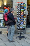 Tourists choose cards in Bordeaux Stock Photos