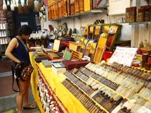 Tourists choose from a variety of souvenir products at a store or shop in Chinatown, Singapore. Royalty Free Stock Photo