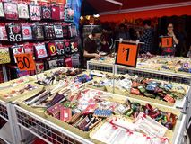 Tourists choose from a variety of souvenir products at a store or shop in Chinatown, Singapore. Royalty Free Stock Image