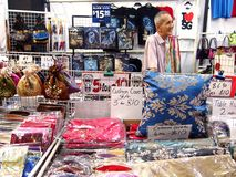 Tourists choose from a variety of souvenir products at a store or shop in Chinatown, Singapore. Royalty Free Stock Images