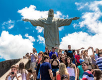 Tourists at the Christ the Redeemer, located on top of Corcovado, in Rio de Janeiro, Brazil Royalty Free Stock Photo
