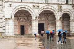 Tourists at Church in Lucca Italy. Stock Photography