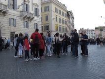 Tourists in the city center of Rome. A group of tourists with guide in the city center of  Rome stock photography