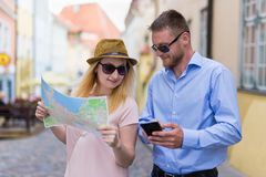 Tourists on city trip using smartphone and city map Royalty Free Stock Image